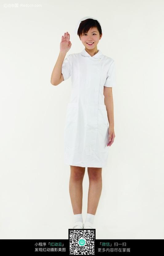 伸出手臂打招呼的白衣护士图片 职业人物图片