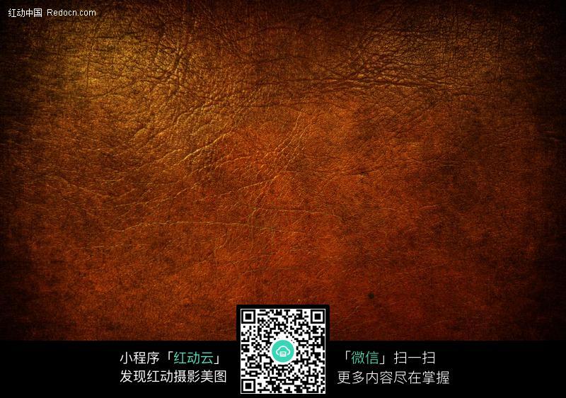 深褐色的皮革纹理背景图片
