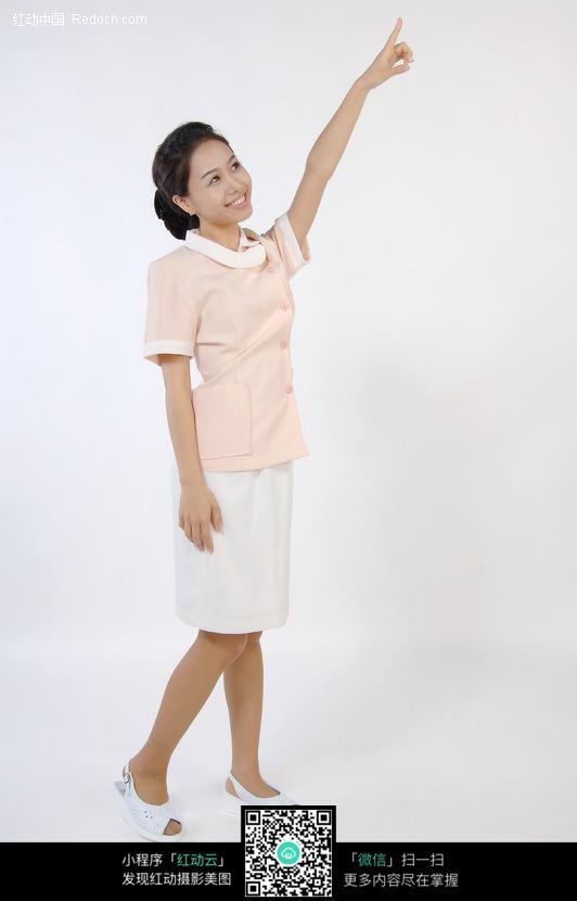 免费素材 图片素材 人物图片 职业人物 美女侧身举起一只手  请您分享