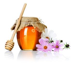 封着口的蜂蜜瓶子和蜂蜜搅拌棒
