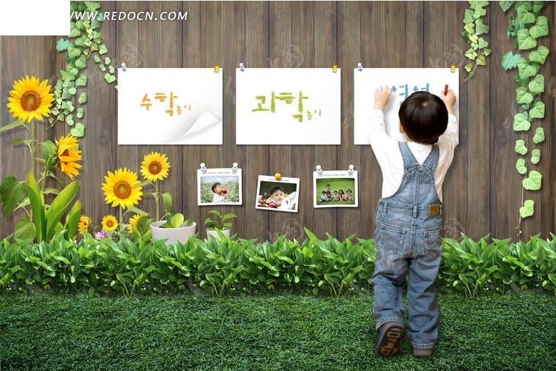 木板墙上贴画纸的小孩
