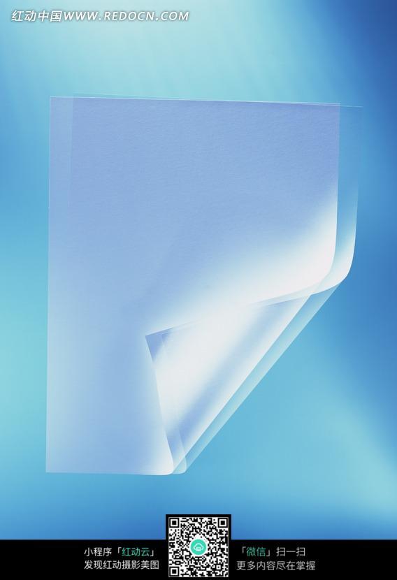 蓝色背景下卷起一角的纸张图片免费下载 编号555223 红动网