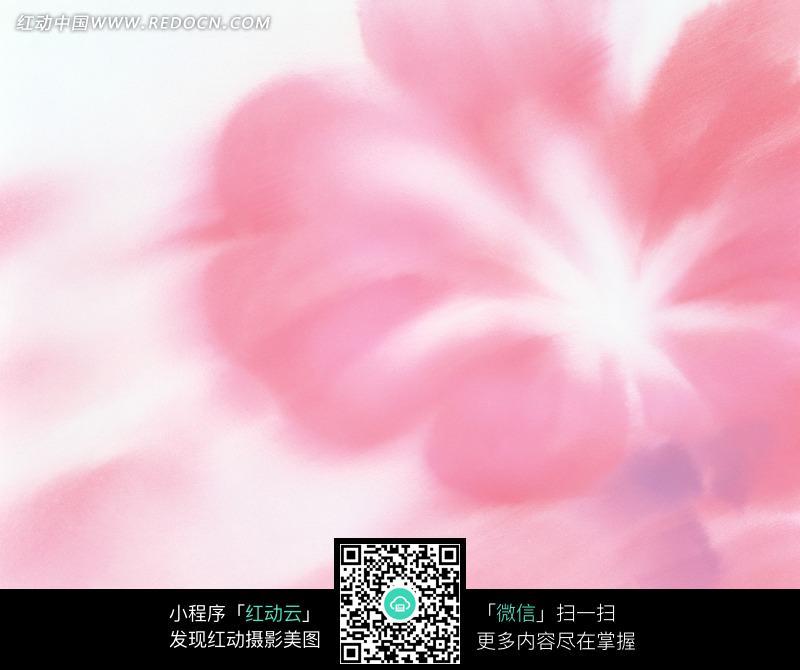 模糊的淡粉色花朵背景图片
