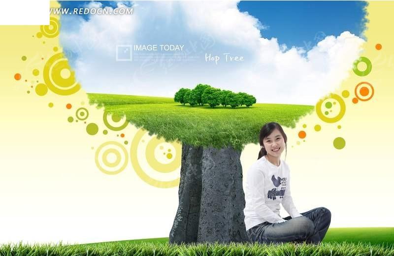 坐在树下的女孩和绿色风景图
