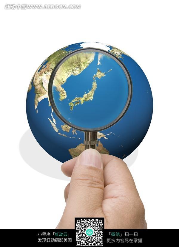 被放大镜放大的日本地形图图片 风景图片|图片