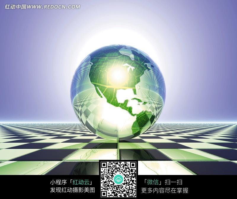 黑白格子和上方绿色地图的水晶地球图片