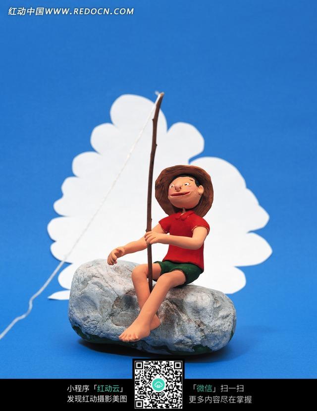 3d卡通人-坐在石头上钓鱼的男子