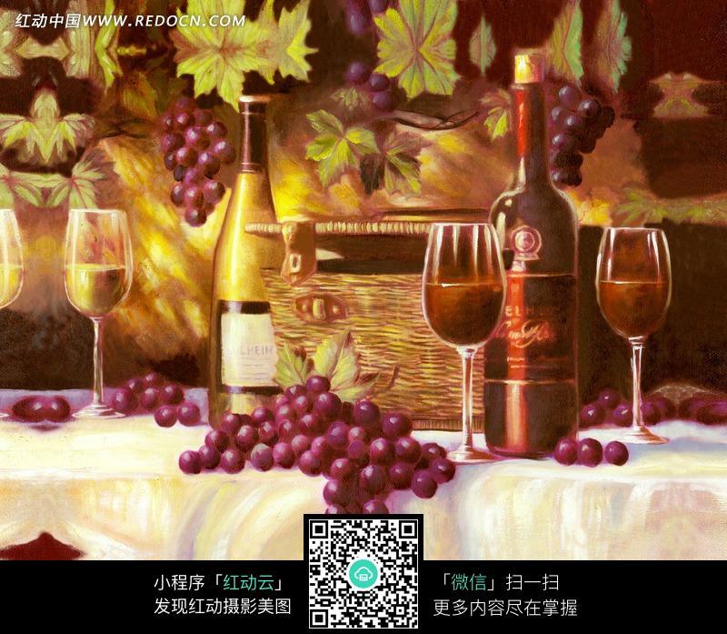 桌子上的酒瓶/酒杯/葡萄圖片