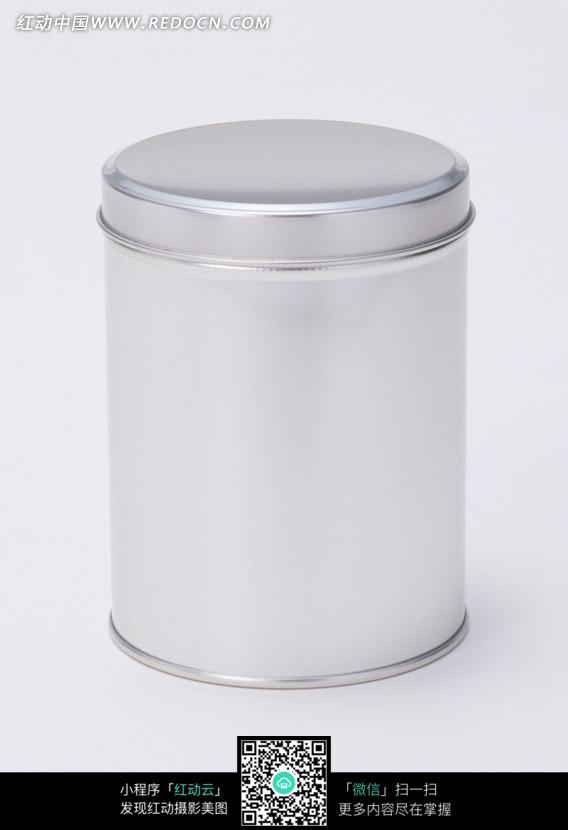 一个金属质感带盖子的圆柱形罐子图片
