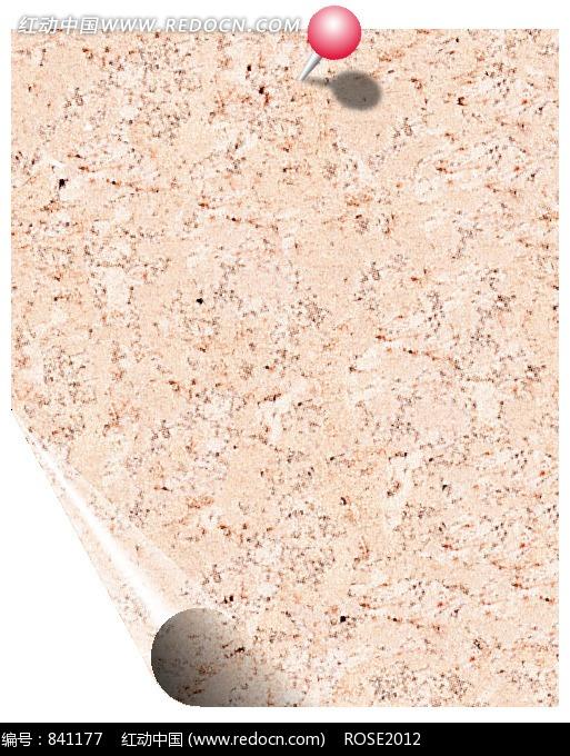 一角卷起的钉住的碎花的浅褐色纸张图片