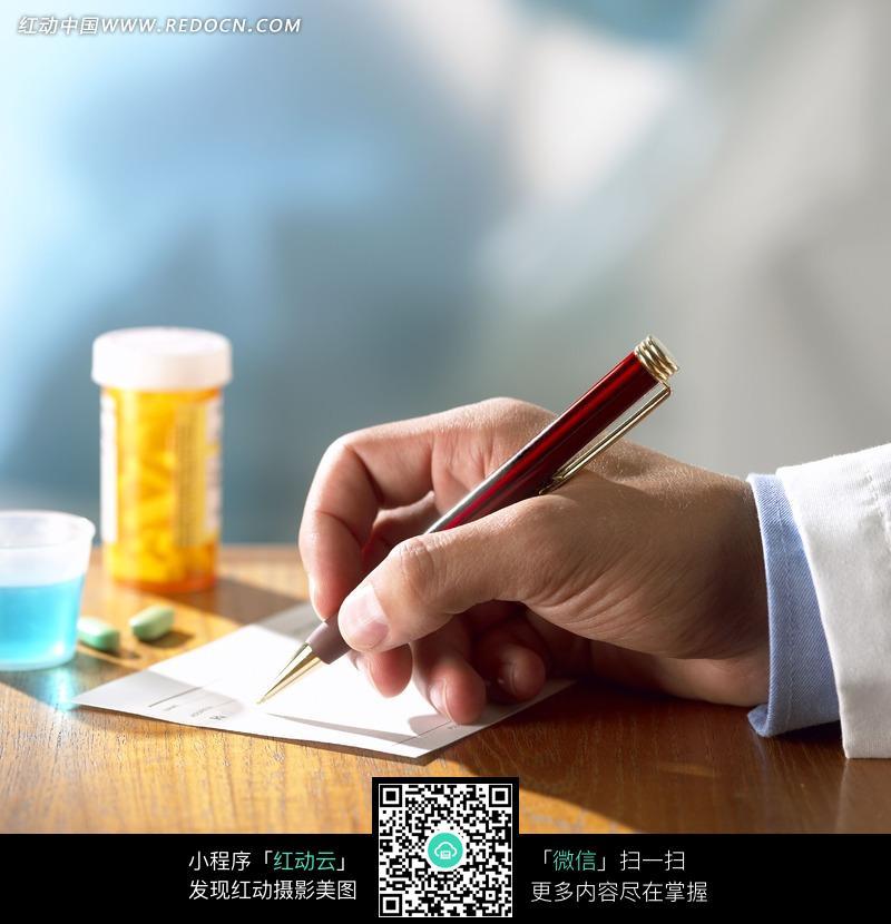 拿着笔写字的手图片免费下载 编号1018811 红动网