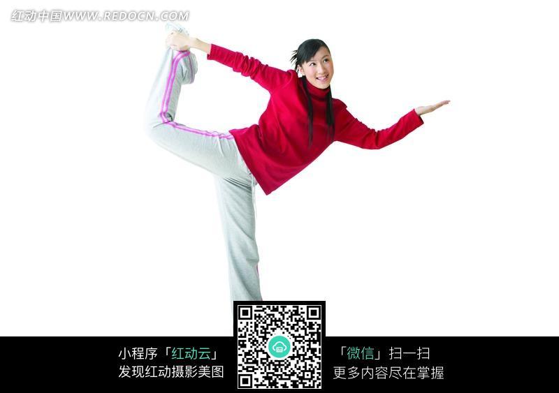 免费素材 图片素材 人物图片 日常生活 单脚站立左手握住右脚的女子