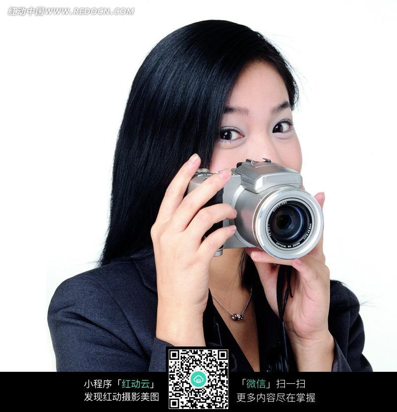 免费素材 图片素材 人物图片 职业人物 拿相机拍摄照片的女人