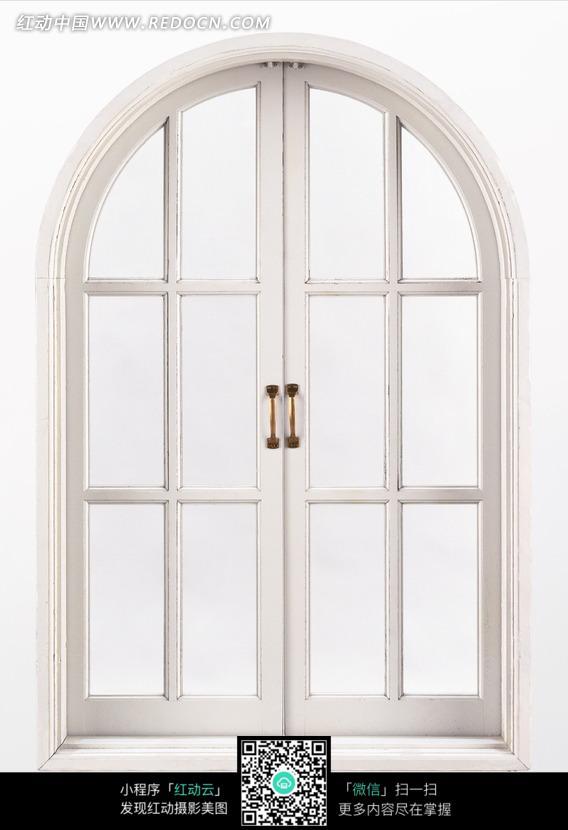 关闭的拱形白色窗户图片