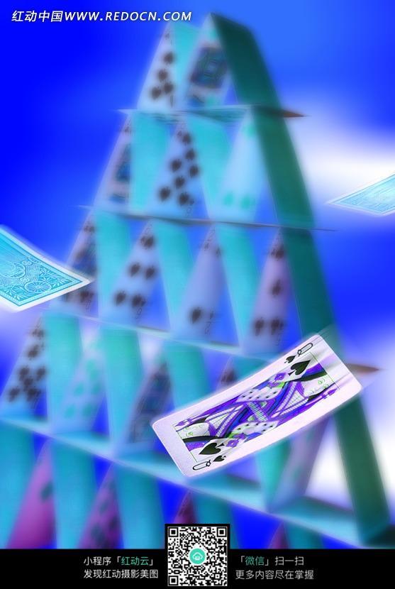 扑克牌垒起的三角塔图片