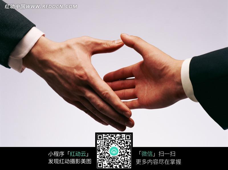 两个准备握手的手图