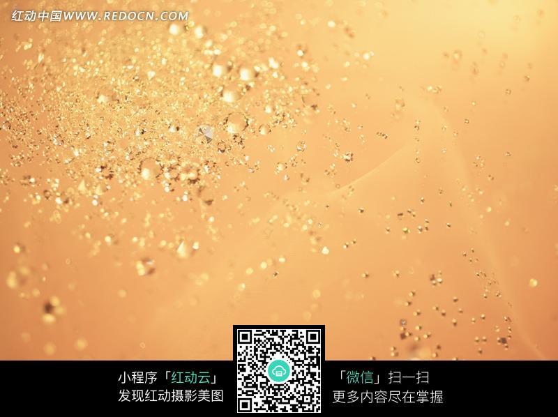 橙色背景上闪烁的钻石暖色调摄影图图片免费下载 编号1382237 红动网图片