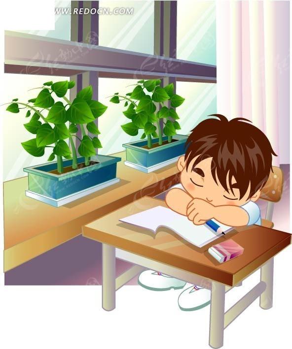 趴在课桌上睡觉的小男孩