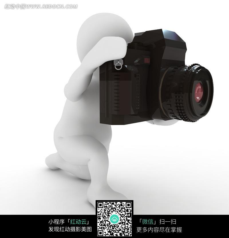 拿着 照相机