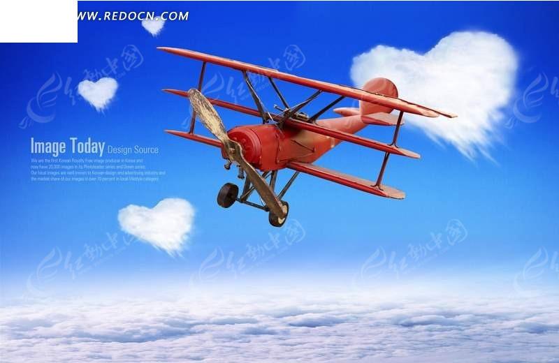 蓝天中飞翔的红色老式飞机