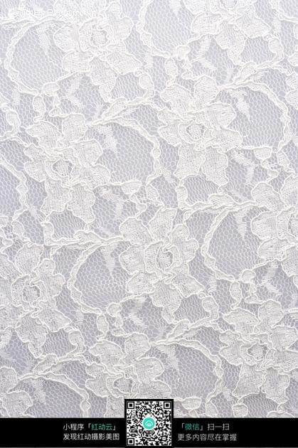 绣着花朵的白色纱布图片_底纹背景图片图片