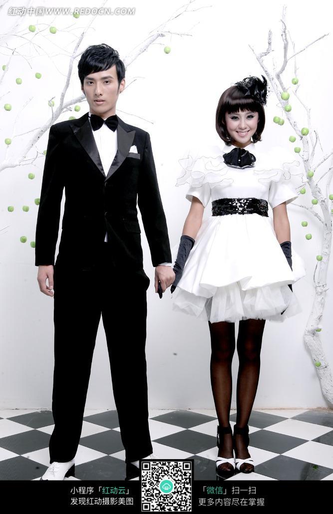 免费素材 图片素材 人物图片 新人情侣 手牵手站立的新郎新娘