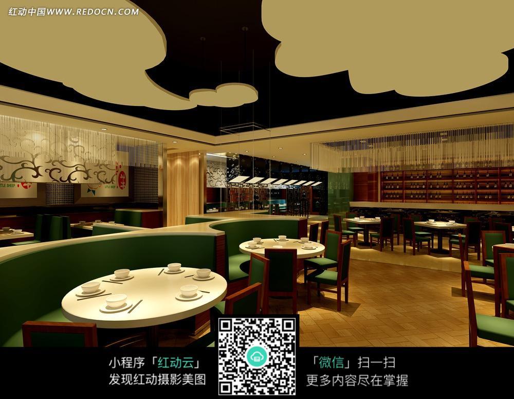 绿色餐厅内的白色圆桌和绿色椅子图片