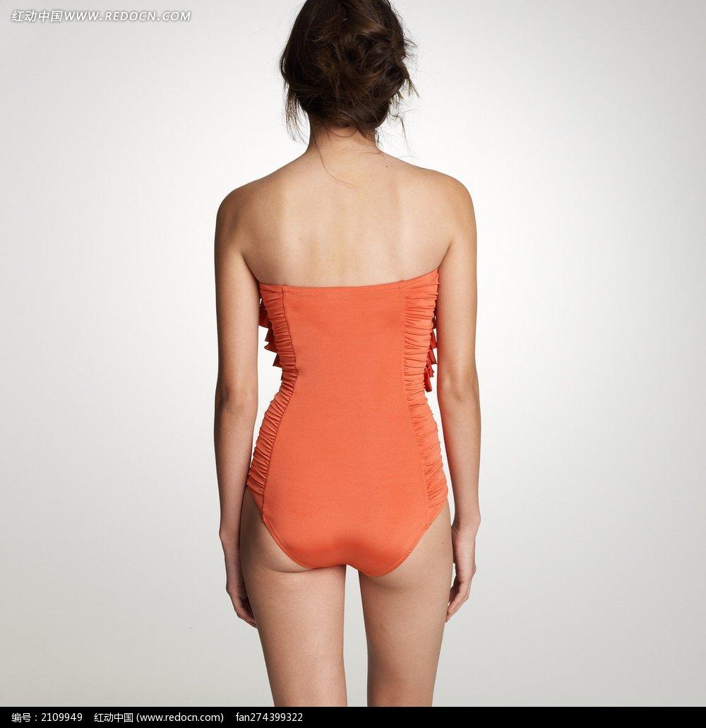 穿橙色连体式泳衣的外国美女背影图片