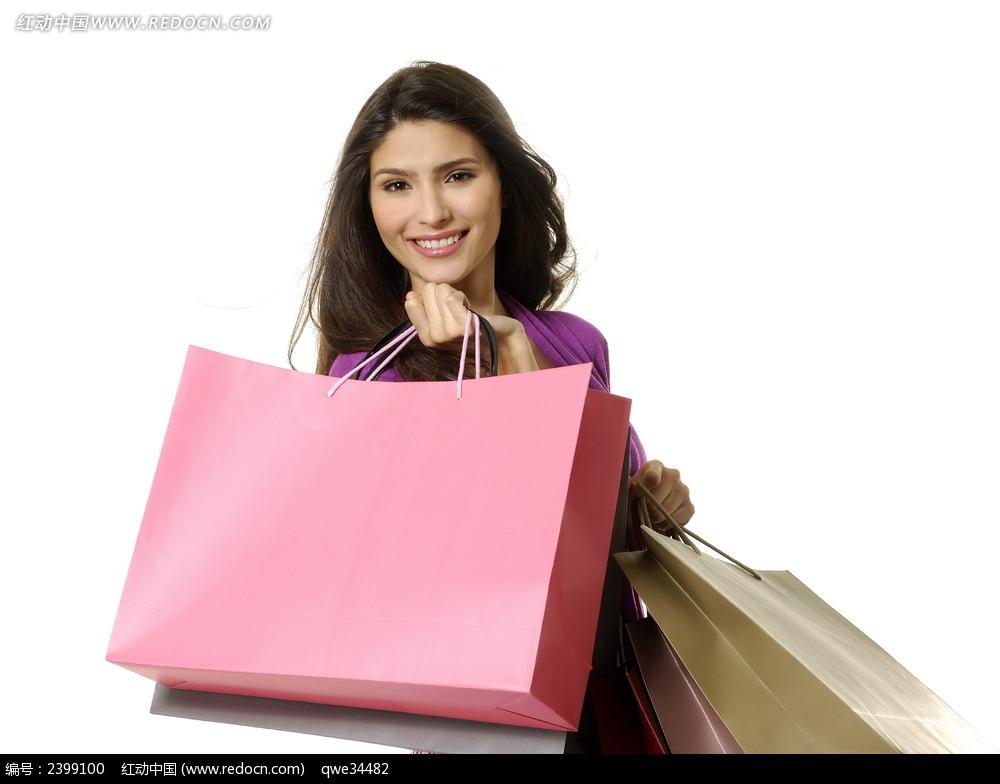 面带微笑的披肩发购物美女图片 女性女人图片