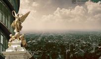 人物雕塑下的都市鸟瞰图