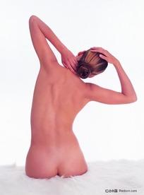 屈臂歪脖的裸体美女