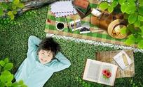 躺在草地上的小男孩图片素材