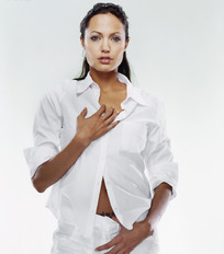 靠在墙边穿白衬衣的性感美女图片