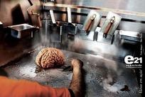 一个正在用铲子铲起脑子的创意广告图片