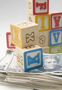 英文字母方块积木与美元