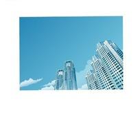 蓝天下的高楼大厦远处仰视图