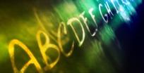 短片视频 幻彩光影照射石壁上的26个英文字母