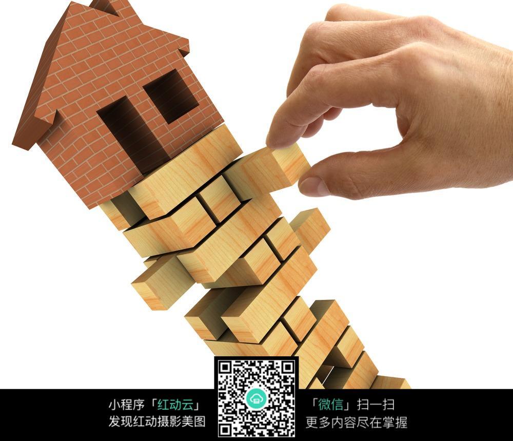 手堆积木房子图片素材