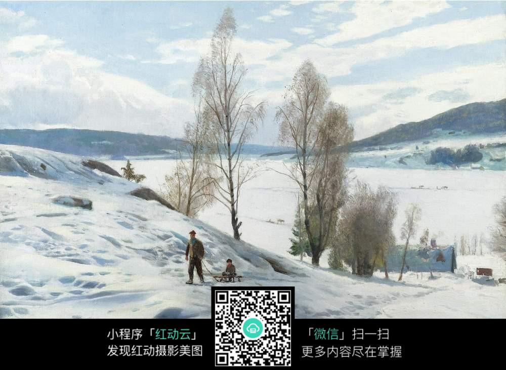 雪地中拖着雪橇的男人图片