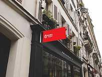 商业街店铺门脸伸出的红色广告牌样机