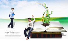 坐在书上的学生和向日葵