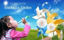 草地上吹泡泡的女童背景素材