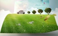 绿色草地画卷上的汽车和小树PSD