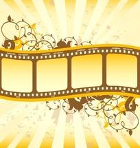 黄色放射性背景上的卷草图案与电影胶片