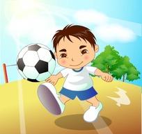 在沙地上踢足球的小男孩