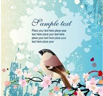 蓝色花纹背景上可爱的小鸟桃花花纹卡片设计