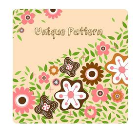 手绘粉色背景上的绿叶和各色花朵